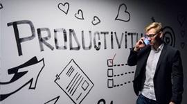 Wall-art reading 'productivity'.