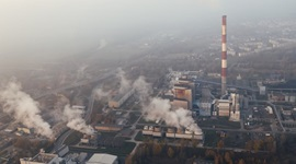 View above an industrial plant producing smoke.