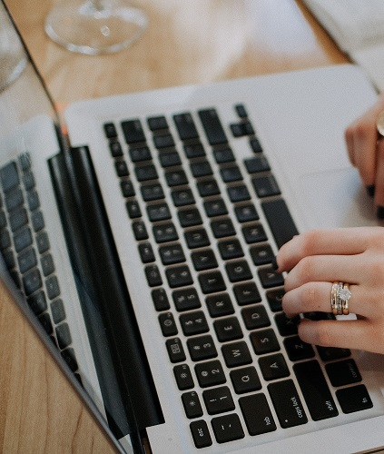 female hand using laptop